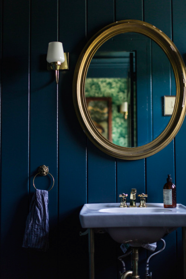Blue Bathroom with Brass Accents