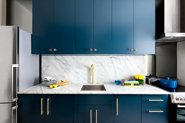 Blue Cabinets with Brass Handles & Gold Faucet